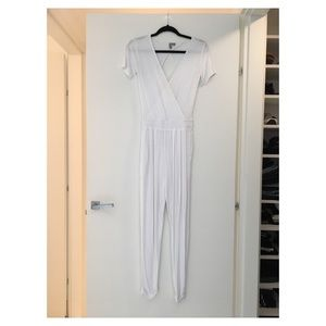 White jumpsuit with cutout back and plunging neck